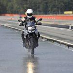 biker on road with helmet and wet asphalt